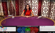 A smaller in-game image of a female Baccarat dealer at the Genesis live casino.