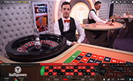 A smaller image of a male croupier wearing an orange bowtie hosts a roulette wheel for the LeoVegas live casino.